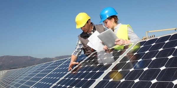 workers evaluating solar pannels