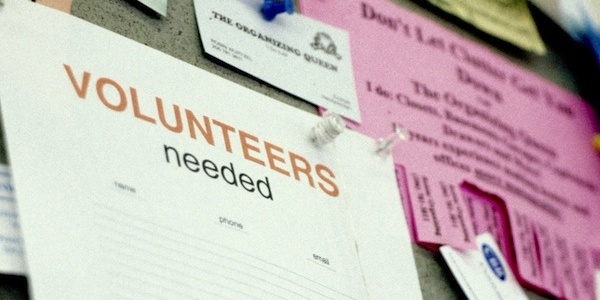 volunteer sign-up sheet on a bulletin board